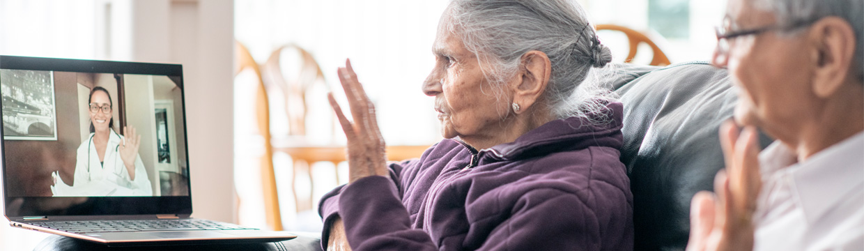 elderyly woman and man receiving virtual care